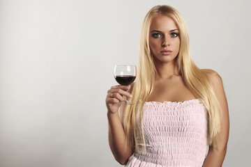 Beautiful blond girl with red wine.young woman.alcohol