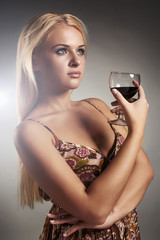 Beautiful blond woman with red wine.woman with alcohol
