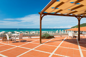 orange tiled terrace with desk and chairs with shadow roof