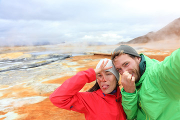 Iceland funny tourists selfie at mudpot hot spring