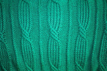 Background texture of knitted green pullover