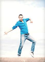 handsome boy making dance move