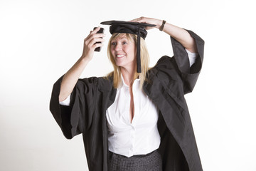 Student in cap and gown taking a selfie photo