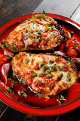 Roasted eggplant stuffed with tomatoes, cheese and herbs