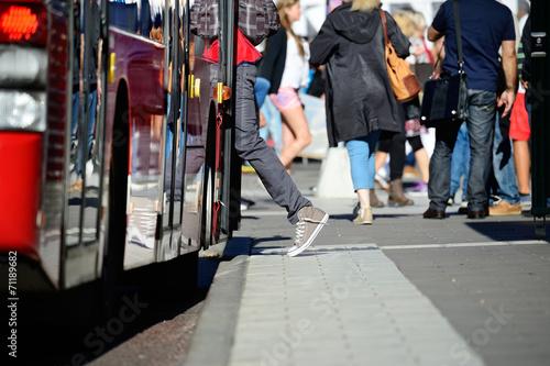 Leinwanddruck Bild Person enters bus