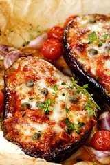 Grilled eggplant with tomatoes, garlic and melted cheese