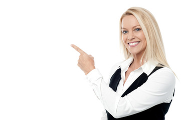 Businesswoman pointing, isolated on white