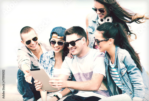 canvas print picture group of teenagers looking at tablet pc