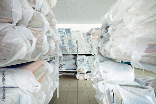 Image of racks with clean clothes in laundry room