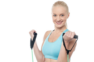Instructor with exercise bands isolated on a white