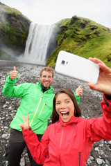 Couple taking selfie smartphone picture waterfall