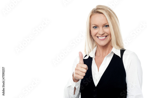 canvas print picture Happy business woman giving thumbs up