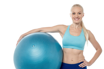 Young smiling woman with fitball