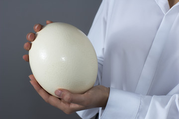 Woman with ostrich egg in her hands