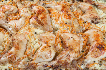 chicken legs with rice and carrots