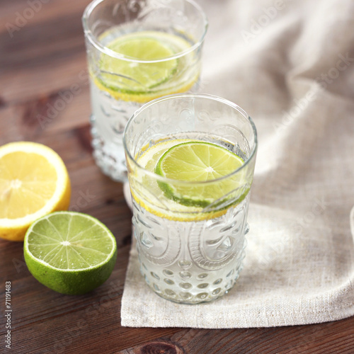 canvas print picture Beverage with lemon and lime
