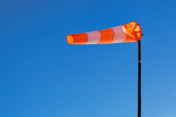 Windsock with blue sky