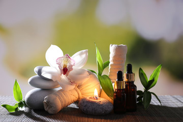 Spa composition with herbal massage bags, candle and bamboo