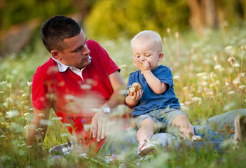 Father with son having picnic