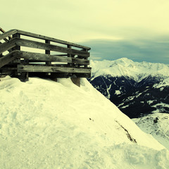 Wooden terrace at mountain ski resort in Alps, Austria