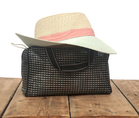 the straw hat and handbag isolate on white background