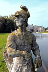 Statue by the pool in the huge park of Villa Pisani, Italy