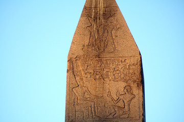 Egyptian hieroglyphics carved on ancient obelisk