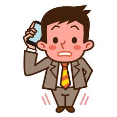 電話中に照れるビジネスマン