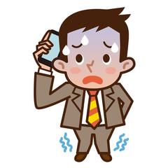 青ざめた表情で電話をかけるビジネスマン