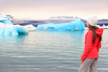 Iceland glacial lagoon - woman looking at view