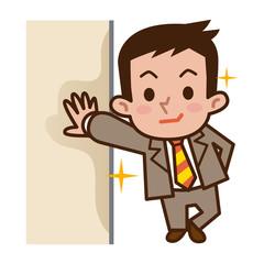 壁に寄り掛かるビジネスマン