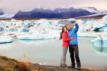Iceland - couple taking selfie by Jokulsarlon