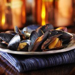 plate of mussels covered in garlic white wine sauce