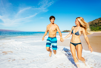 Attractive Happy Couple Running and Playing on Beach