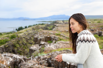 Iceland - woman looking at Thingvellir Althing