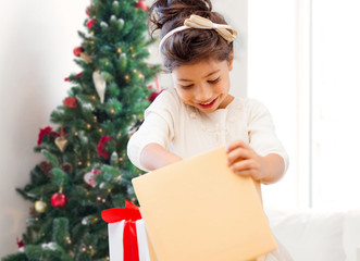 smiling little girl with gift box