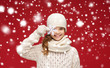 canvas print picture - smiling girl in winter clothes with big snowflake
