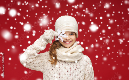 canvas print picture smiling girl in winter clothes with big snowflake