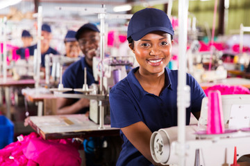 young african textile worker in factory