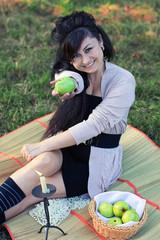 girl gives an apple