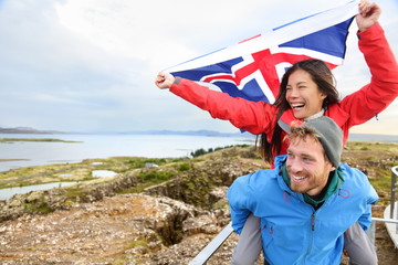 Iceland travel - couple with Icelandic flag