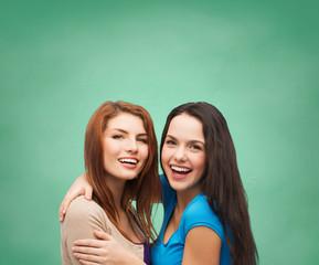 smiling teenage girls hugging