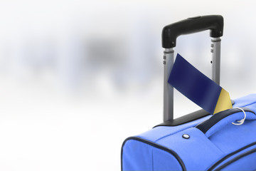 Blue suitcase with blank label at airport.