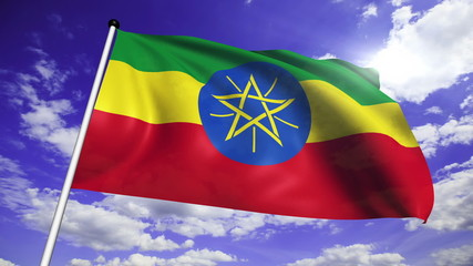 flag of Ethiopia with fabric structure against a cloudy sky