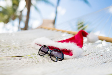 hammock with santa helper hat and shades