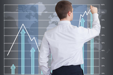 Businessman drawing a graph showing the success of the company