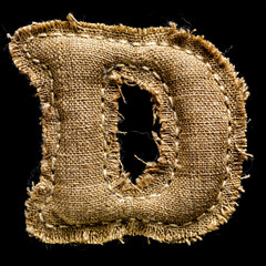 Linen or hemp vintage cloth letter D isolated on black