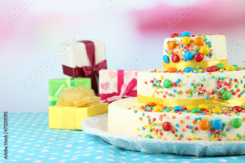 canvas print picture Beautiful tasty birthday cake and gifts on light background