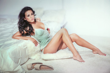 Sensual brunette woman in bedroom