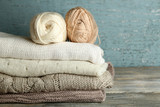 Fototapety Knitting clothes and yarn on wooden background